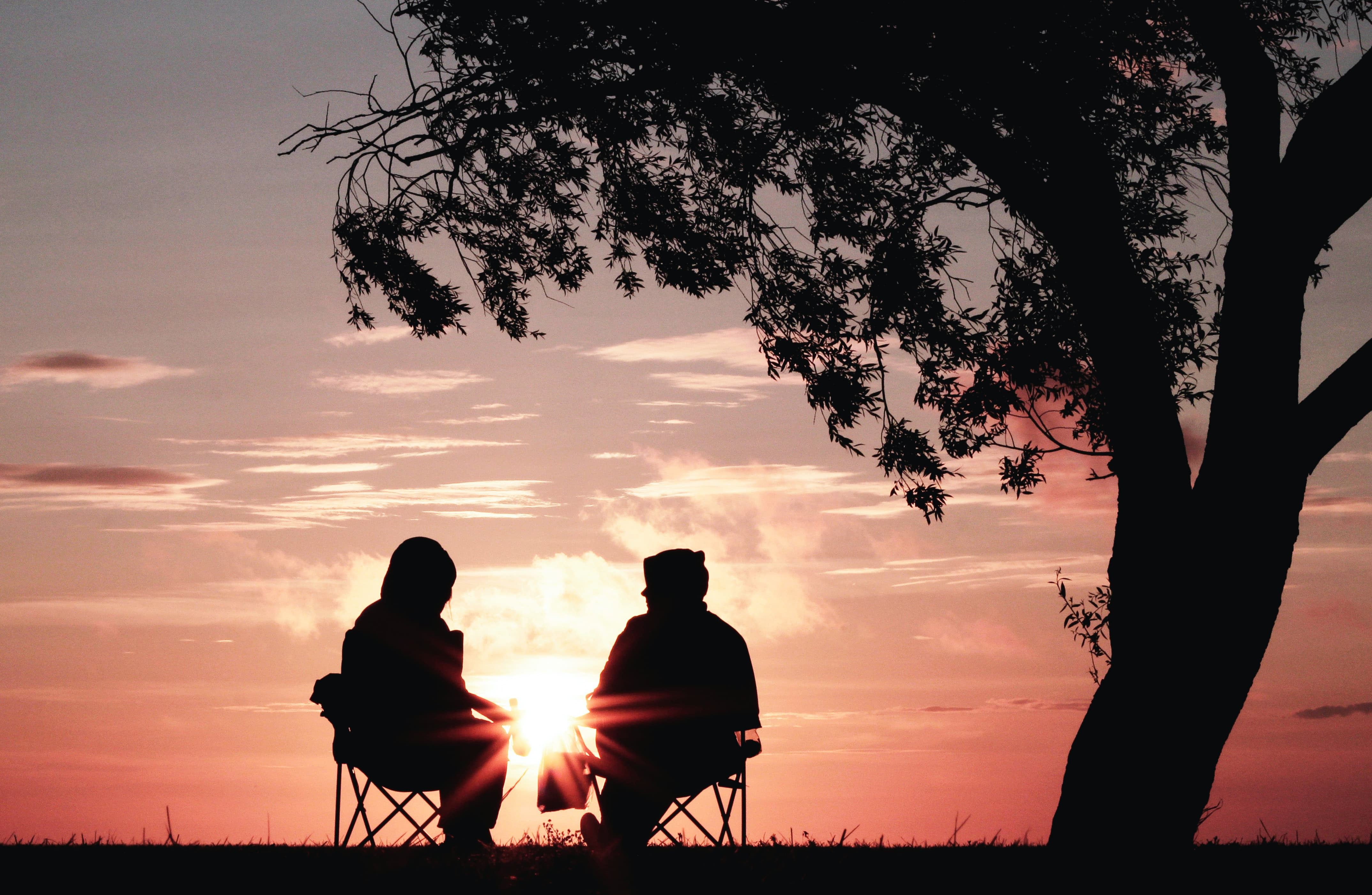 two people watching sunset